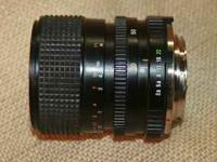 MINOLTA 35-70 ZOOM LENS. f3.5-4.8 MD manual focus 35mm