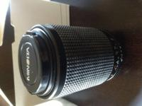 I HAVE A BRAND NEW MINOLTA TELEPHOTO LENS FOR SALE. IT