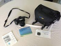 I am selling a used Minolta Maxxum 330si RZ film camera