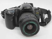 Minolta Camera -- Body Only  Maxxum 450 si SLR Camera