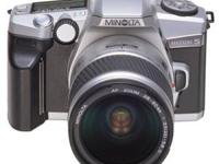 Like new, Minolta Maxxum 5, 35mm SLR w/ 28-80mm lens.