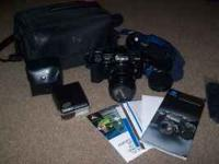 for sale is a minolta 7000 maxxum camera package. it