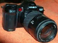 MINOLTA MAXXUM 7000 i CAMERS WITH 70/210 LENS. THIS