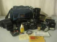 Minolta Maxxum AF 7000 SLR camera with case, strap and