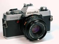 THREE 35mm FILM CAMERAS:  MINOLTA XG-1 35mm SLR (SN