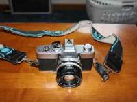 Up for sale is Minolta SRT-SCII 35mm SLR camera outfit.