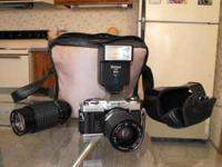 Minolta X-370 film camera with flash, carrying case,