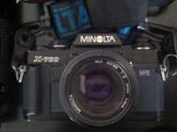 This Minolta X-700 35mm Camera comes with: - Case -