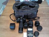 35MM CAMERA GREAT SHAPE COMES WITH 4 LENS CARRY BAG AND