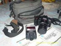 minolta maxxum 5000 w/zoom 28 to85 mm.,comes with