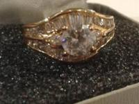 This is a beautiful 14K Gold Ring with a Cubic Zirconia