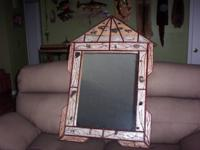 This mirror is new and wonderfully handcrafted with