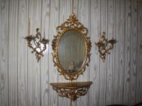 This mirror ensamble will bring ornate elegance to any