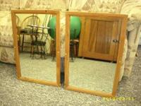 Two wood trim mirrors; very good condition. both for