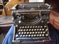 all antiques ... typewriter,$40.00, primitive box, no