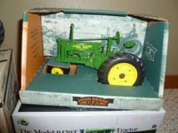John Deere B tractor new in box.  $35  Deutz Allis 9150