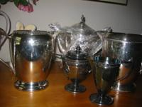 A lot of nice silverplate for hosting parties and