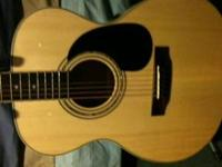 Mitchell concert sized acoustic guitar. its it great
