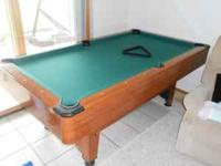 This is a Mizerak pool table. It is smaller than