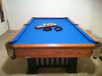 This is a Mizerak pool table with leather pockets,