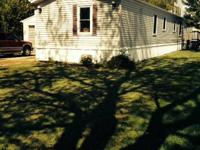 1995 16 X 80 MOBILE HOME LOCATED IN HILBERT ACRES MHP,