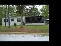Landscaped and very nice 14 X 60 mobile home with