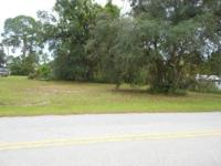Vacant land measures approx. 100 x 550 or 1.25 acres.