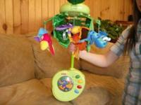 Fisher Price mobile with music and auto turning top has