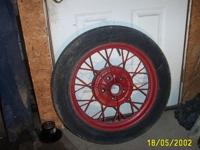 2 model A. ford wheels 21 inch oem. one in good