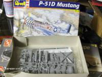 I have 3 model car kits.  Open but not assembled.  one