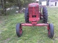 Model M Farmall tractor with heavy duty 5 foot bushhog.