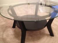 I am offering two coffee tables that I bought as a set
