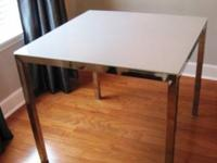 Hi, I have a Chrome and Glass Dining Table for sale.