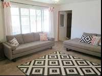 Brown fabric couches. One couch is like a twin bed and