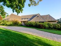 Set on 2+/- bucolic acres with 700+/- feet of water