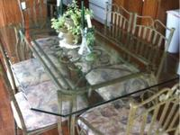 Metal and glass dining room suite. Consists of 66""