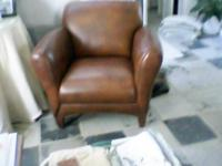 One Recliner,dark brown leather, very comfortable . One