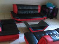 4 piece leather red and black sectional. Like new