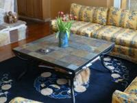 Black steel and slate coffee table, has lower lovel to