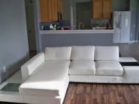 This Modern White Compact Leather Sectional Sofa is