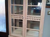 This is a sleek display cabinet with three glass
