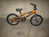 Orange and black like new mongoose trick bike. We paid