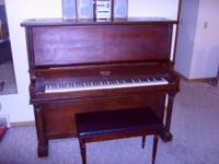 Vintage Monarch Upright piano with Bench for sale. You