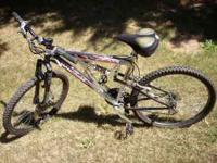 21 speed mountain bike used very little, wide seat on