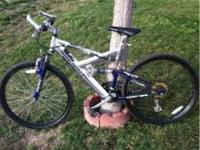 "Mongoose Mountain Bike 26"" wheels and 21 speeds. Firm"