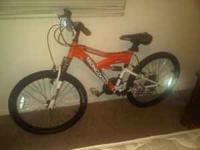 Brand new orange Mongoose Boy's bike. Never riden since