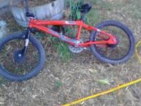 It's a red mongoose Fuzz extreme bmx bike both back