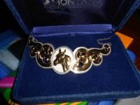 MONTANA SILVER HORSE NECKLACE HAS SILVER AND GOLD IT IS