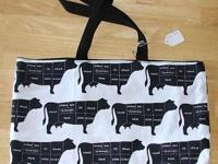 a cute simple moo cow tote with black lining. New. A