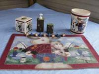 This is a cute moose bathroom set that includes a rug,